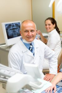 Mature dental surgeon in office