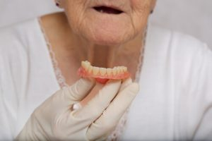how to fix a broken denture tooth