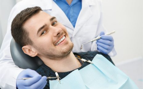 The man is getting dental treatment.