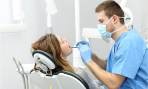 The patient visits her dentist because she is experiencing mouth pain.
